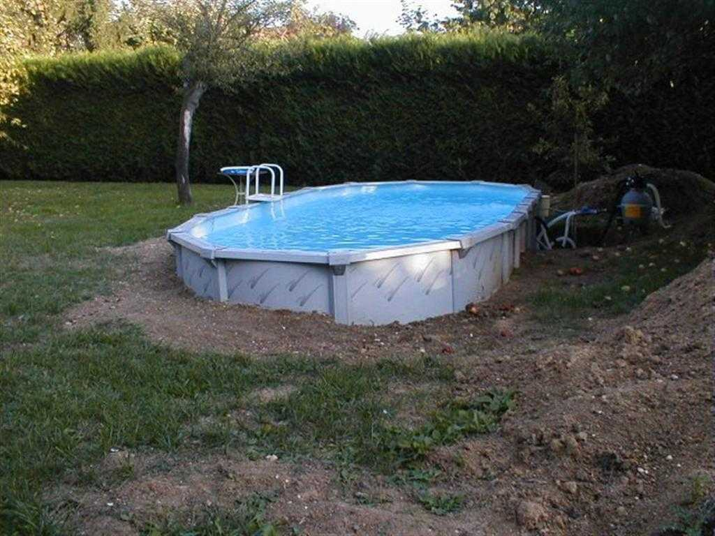 Piscine hors sol semi enterr e acier for Piscine structure bois semi enterree